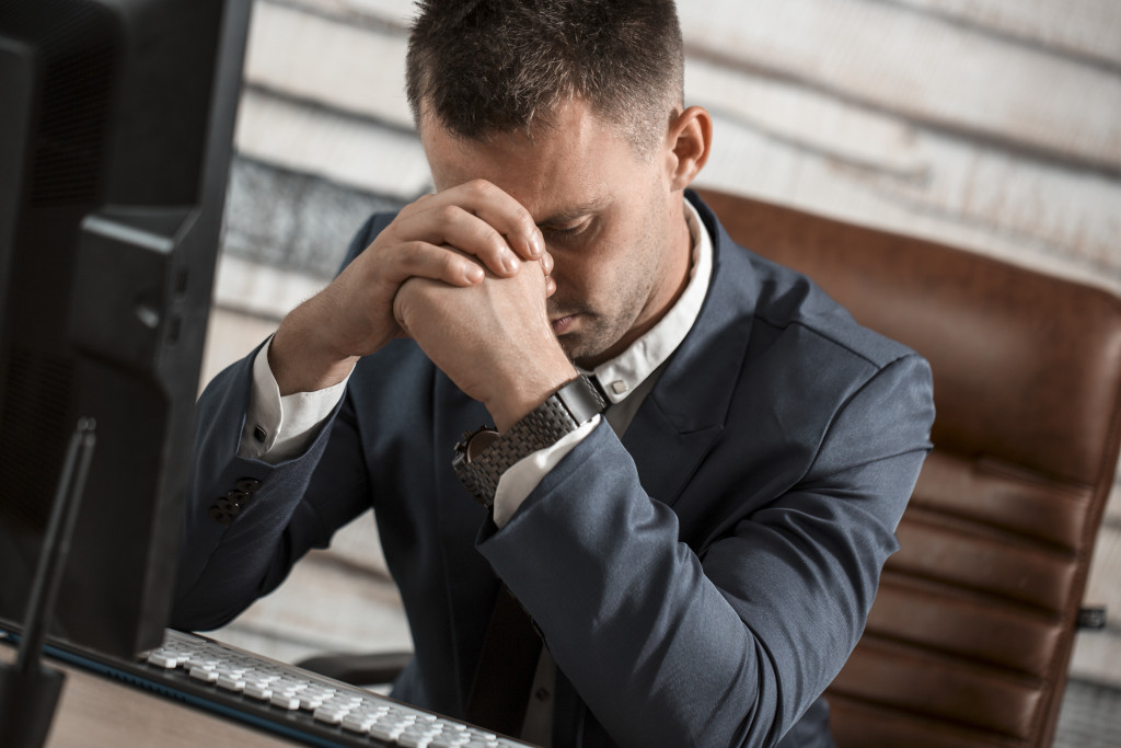 Man sad in front of computer